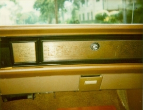 1970 Chrysler Newport Cordoba metal appliqué on glovebox and A/C outlet delete showing variations of the Aztec Eagle motiv.