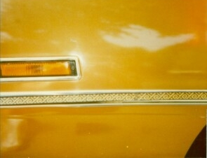 1970 Chrysler Newport Cordoba body side molding with Aztec appliqué